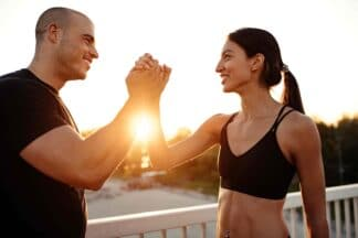 male and female dubai personal trainers working together and shaking hands